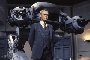 Ronny Cox (Dick Jones) et ED- 209